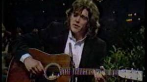 "Click and enjoy Guy Clark singing ""Home Grown Tomatoes"" from the early 70's (and try not to smile)."